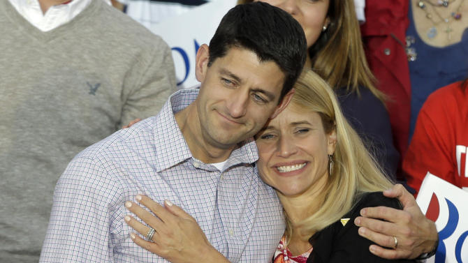 FILE - In this Aug. 12, 2012 photo, vice presidential candidate Rep. Paul Ryan, R-Wis, left, hugs his wife Janna during a welcome home rally in Waukesha, Wis. A review of Ryanís financial statements by The Associated Press shows that he is in the wealthiest percentiles of Americans. His income is between $344,000 and $1.4 million. Much of his money comes from a trust fund set up following his mother-in-law's death, as well as investments in natural resources. He also earns an annual salary as a member of Congress of $174,000. (AP Photo/Jeffrey Phelps, File)