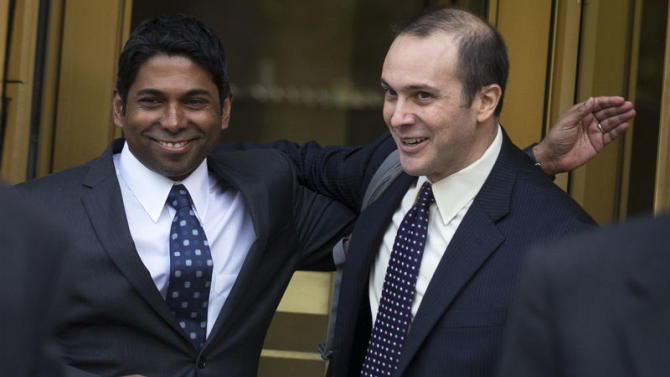 Rengan Rajaratnam embraces his lawyer Daniel Gitner as they exit the U.S. District Court for the Southern District of New York in Lower Manhattan