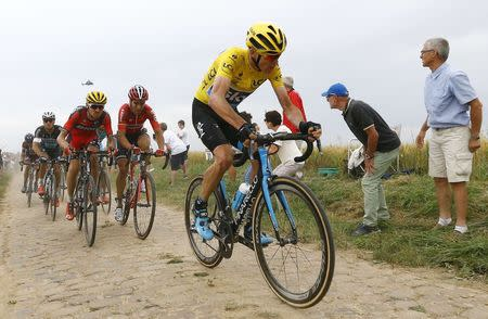 Team Sky rider Froome of Britain cycles on a cobble-stoned section during the 4th stage of the 102nd Tour de France cycling race from Seraing to Cambrai,