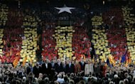 <p>Artur Mas (C), leader of Spain's Catalonia region, stands amid supporters at the end of a final meeting for his re-election campaign. Mas vowed on Friday to fight for the 'future of our nation' before a roaring crowd of supporters, ahead of weekend elections that could lead to a popular demand for statehood.</p>