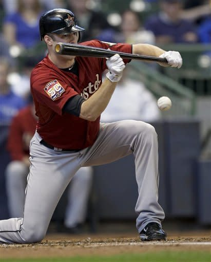 Lyles' arm and bat lift Astros, eliminate Brewers