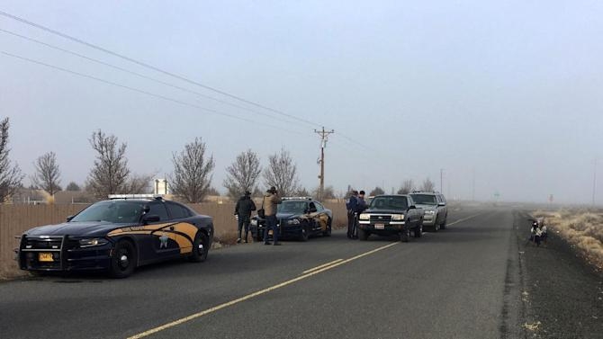 Authorities wait near the Malheur National Wildlife Refuge, Thursday, Feb. 11, 2016, near Burns, Ore. The last four armed occupiers of the national wildlife refuge in eastern Oregon said they would turn themselves in Thursday morning, after law officers surrounded them in a tense standoff.  (AP Photo/Rebecca Boone)