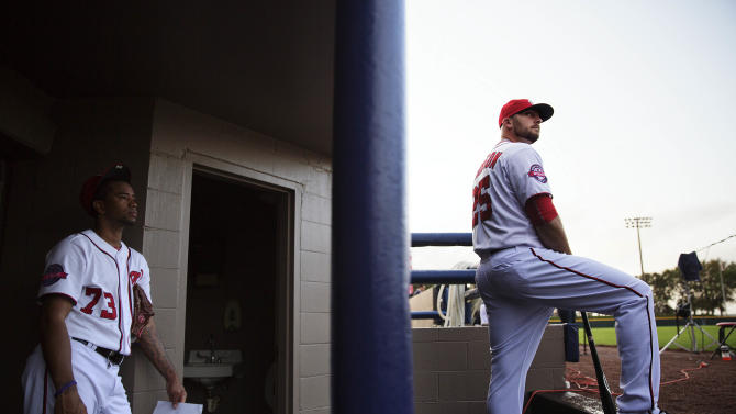 Washington Nationals' Clint Robinson, right, and teammate Felipe Rivero, left, wait to have their picture taken during photo day at the team's spring training baseball facility, Sunday, March 1, 2015, in Viera, Fla. (AP Photo/David Goldman)