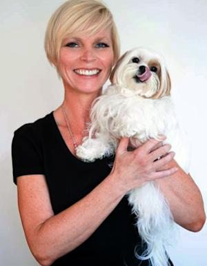 "This undated image provided by Candice Ball shows Ball holding her dog, Toshi. Ball, of New York City, was tired of wasting money on training classes that didn't work for her or her 6-year-old shih tzu Toshi. ""I failed the classes. He wasn't treat-motivated. We sat and stared at each other. Then someone recommended Babette Haggerty's and her praise-only training methods."" she said. A well-trained Toshi has since appeared on ""Law and Order: SVU,"" the final episode of ""30 Rock"" and in a New York Yankees commercial for MasterCard. (AP Photo/Candice Ball)"