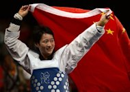 China's Wu Jingyu celebrates her victory over Spain's Brigitte Yague Enrique at the end of their women's taekwondo gold medal bout in the category under 49 kg as part of the London 2012 Olympic games, at the ExCel centre in London