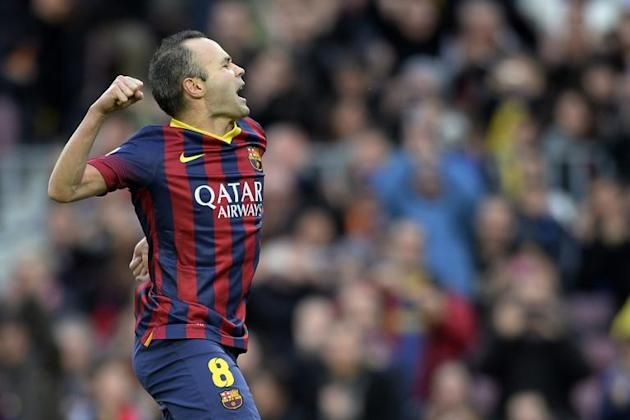 Barcelona's midfielder Andres Iniesta celebrates after scoring during the Spanish league football match FC Barcelona vs CF Granada at the Camp Nou stadium in Barcelona on November 23, 2013