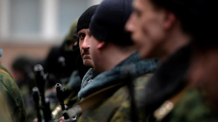 "Pro-Russian forces dubbed the ""military forces of the autonomous republic of Crimea"" stand before their swearing-in ceremony in the Republican military enlistment complex in Simferopol on March 10, 2014"