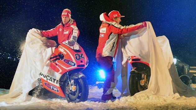 Ducati riders Nicky Hayden (R) and Andrea Dovizioso unveil their Ducati motorbikes during the Wrooom, F1 and MotoGP Press Ski Meeting, Ducati and Ferrari&#39;s annual media gathering, in Italy.