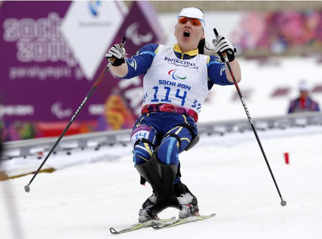 Ukraine's Lyudmyla Pavlenko reacts to winning the gold medal during the women's 12 km cross-country sitting at the 2014 Sochi Paralympic Winter Games in Rosa Khutor