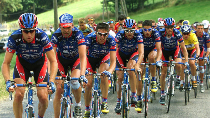 FILE - In this July 15, 1999, file photo, the U.S. Postal Service team including, from left, Christian Vandevelde, Peter Meinert-Nielsen, of Denmark, Pascal Derame, of France, Kevin Livingstone, George Hincapie, Frankie Andreu, Lance Armstrong and Tyler Hamilton, controls the pack during the 11th stage of the Tour de France cycling race between Le Bourg D'Oisans and Saint-Etienne, central France. Armstrong won his first Tour de France title in 1999_but in 2012 Armstrong was stripped of his seven Tour de France titles and banned for life by cycling's governing body. (AP Photo/Laurent Rebours, File)