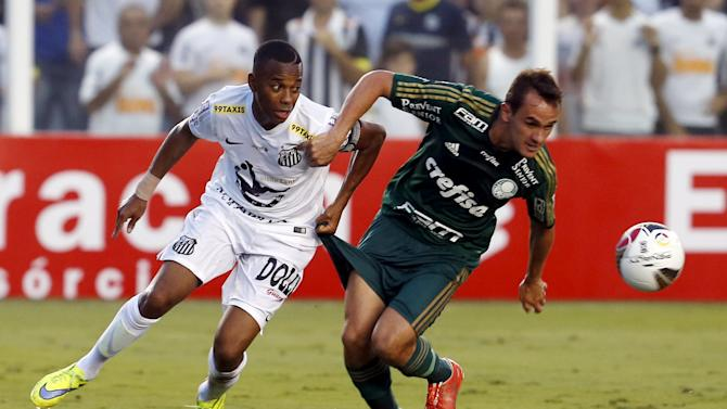 Robinho of Santos challenges Lucas of Palmeiras during their Sao Paulo state championship final soccer match in Santos