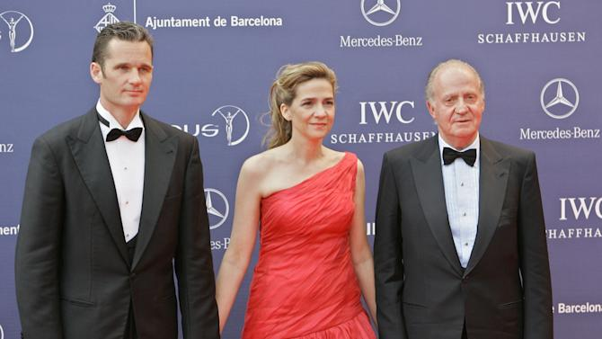 FILE - In this May 22, 2006 file photo, Spain's King Juan Carlos, right  arrives with his daughter, Princess Cristina, centre and her husband, Inaki Urdangarin, for the Laureus World Sports Awards in Barcelona, Spain. On Wednesday April 3, 2013 a Spanish court named the king's daughter Princess Cristina as a suspect in a corruption case involving her husband and will be called in for questioning on April 27.(AP Photo/Jasper Juinen, File)