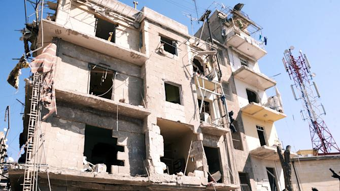"""This photo released by the Syrian official news agency SANA shows a damaged building after a blast in Aleppo, Syria, Sunday, March 18, 2012. An explosion ripped through a residential neighborhood in the northern Syrian city of Aleppo on Sunday and the state news agency said it was a """"terrorist bombing."""" The report by SANA gave no information on casualties in what appeared to be the second attack in two days on cities where President Bashar Assad's regime enjoys strong support. (AP Photo/SANA)"""