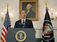US President Barack Obama delivers a statement on Hurricane Isaac in the Diplomatic Reception Room of the White House. He warned of significant damage and flooding, telling people in its path to take the &quot;big storm&quot; seriously and follow directions