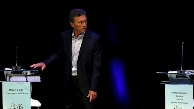 Presidential candidate Mauricio Macri of Cambiemos looks for his lectern before a presidential debate ahead of the October 25 election in Buenos Aires