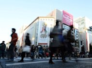 File photo of shoppers in the upmarket Ginza shopping district in Tokyo on December 1, 2012. The sound of Mandarin-speaking tourists and the cash tills they set ringing have become rare in Tokyo&#39;s upmarket Ginza district, retailers say, since a flare-up in an island row between China and Japan