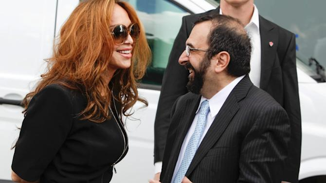 US anti-Islam activists Pamela Geller (L) and Robert Spencer chat ahead of an anti-Islam demonstration in Stockholm, on August 4, 2012