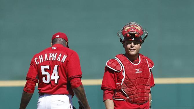 Cincinnati Reds' Devin Mesoraco, right, walks off the mound after speaking with Aroldis Chapman, left, during the third inning of a spring training baseball game against the Cleveland Indians, Thursday, March 5, 2015, in Goodyear, Ariz. (AP Photo/John Locher)