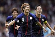 Japan's Yuki Otsu celebrates scoring a goal during the Men's Olympic football match Japan vs Spain at Hampden Park in Glasgow, Scotland. Japan scored a stunning upset of world champions Spain on Thursday in the Olympic football tournament as officials played down a flag blunder which prompted a protest from North Korea