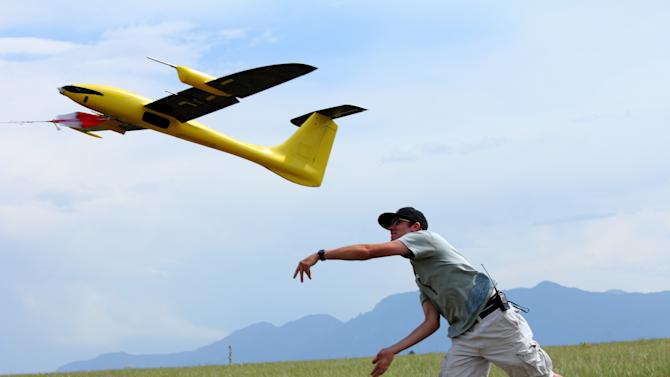 This June 17, 2013 photo, made available courtesy Sean Waugh, NOAA, shows  graduate research assistant Kevin Rauhauser, with the University of Colorado's Research and Engineering Center for Unmanned Vehicles, (RECUV), launching the Tempest unmanned aerial vehicle for a test flight on Table Mountain, near Boulder, Colo. Researchers say they've collected promising weather data by flying instrument-laden drones into big storms, and now they want to expand the project in hopes of learning how tornados form.(AP Photo/Sean Waugh, NOAA)