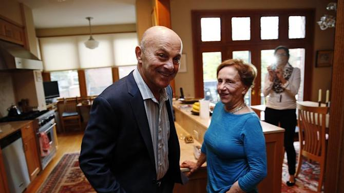 University of Chicago Professor Fama is pictured in his house with his wife after finding out he won the 2013 Nobel Prize in Economics in Chicago