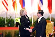 US Secretary of State Hillary Rodham Clinton (L) talks to Vietnamese President Nguyen Minh Triet in 2010. The United States on Friday criticized China's establishment of a new military garrison in the South China Sea as it called on all sides to lower tensions in the hotly contested waters. (AFP Photo/Na Son Nguyen)