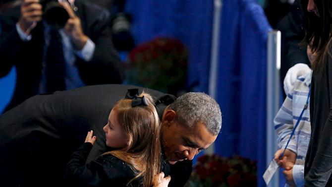 Obama greets family members of fallen firefighters after delivering remarks at the annual National Fallen Firefighters Memorial Service in Emmitsburg, Maryland