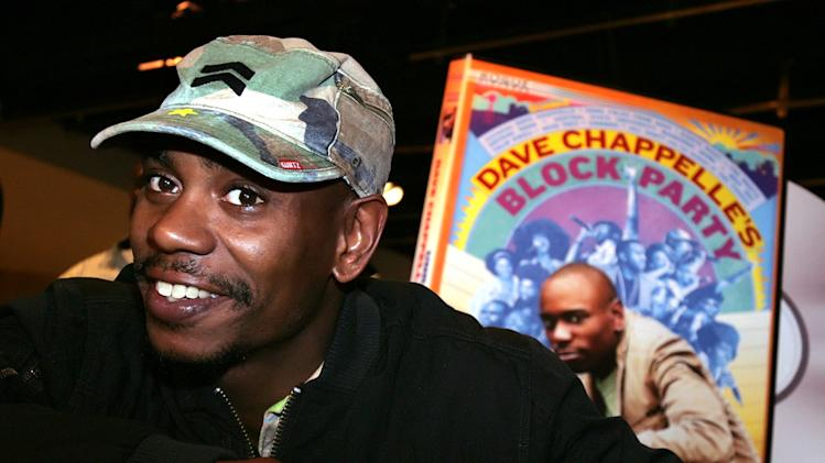 "FILE - In this June 13, 2006 file photo, comedian Dave Chappelle promotes the release of his new DVD ""Dave Chappelle's Block Party,"" at the Virgin Megastore in Los Angeles. Chappelle has struck back at Hartford five days after he was heckled at a show and refused to perform his set. According to audio posted on TMZ.com, Chappelle praises an audience in Chicago on Tuesday for being ""so much better than Hartford."" He tells the crowd that if North Korea were to drop a bomb on the U.S., he hopes it ""lands in Hartford, Connecticut."" Chappelle was the headliner last Thursday in Hartford at the Funny or Die Presents The Oddball Comedy & Curiosity Festival, which is touring the country. (AP Photo/Stefano Paltera, File)"