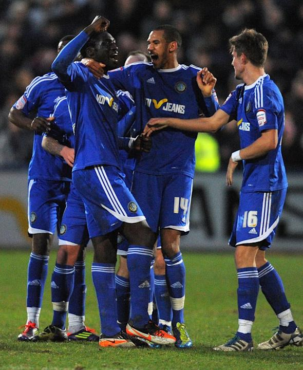Macclesfield Town's Guinean Midfielder Arnaud Mendy (3rd R) Celebrates   RESTRICTED TO EDITORIAL USE. No Use With AFP/Getty Images