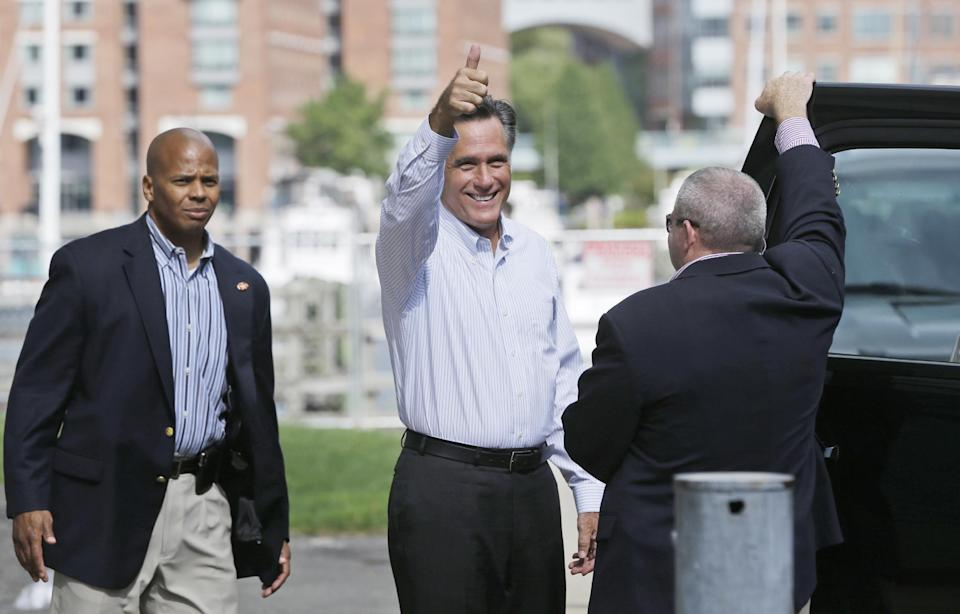 Republican presidential candidate Mitt Romney gives a thumbs up as he leaves his campaign office in Boston, Saturday, Sept. 8, 2012. (AP Photo/Charles Dharapak)