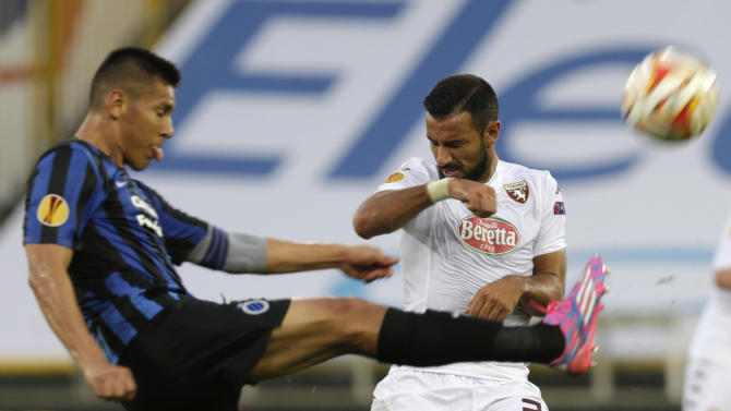 Torino's Fabio Quagliarella, right, is challenged by Club Brugge's Oscar Duarte, during the Europa League Group B soccer match between Club Brugge and Torino, in Bruges, western Belgium, Thursday, Sept. 18, 2014. (AP Photo/Yves Logghe)