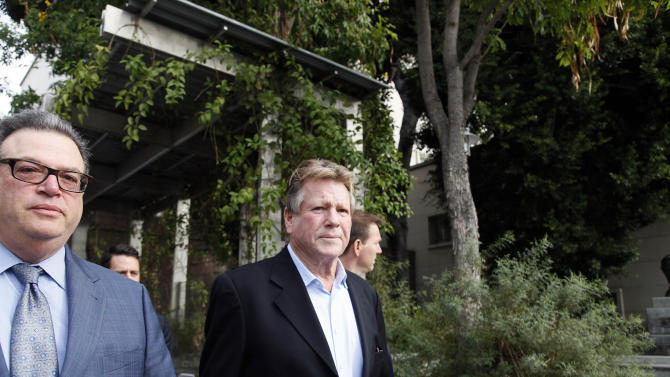 In this Monday, Dec. 2, 2013 file photo, actor Ryan O'Neal, right, leaves court after he testified in a Los Angeles courtroom about his relationship with Farrah Fawcett and his claimed ownership of an Andy Warhol portrait of the actress. A reality TV producer told a jury on Wednesday Dec. 4, 2013, that he believes O'Neal stole a Warhol portrait of Fawcett taken from the late actress' condominium. Craig Nevius provided photos and video that is being used by the University of Texas at Austin in its case against O'Neal to gain possession of the portrait, which the actor says was a gift from Warhol. (AP Photo/Nick Ut, File)