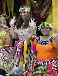 Catherine (C), the Duchess of Cambridge, takes part in a traditional dance during a dinner event in Funafuti on Tuvalu