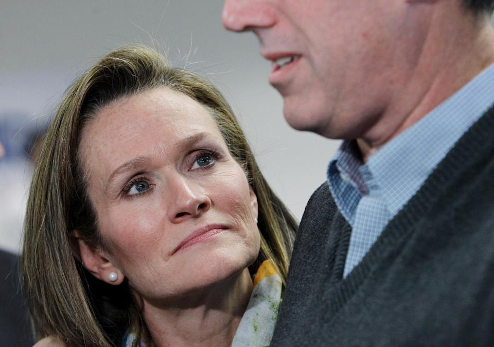 Karen Santorum listens to her husband, Republican presidential candidate, former Pennsylvania Sen. Rick Santorum, as he talks to the media during a stop at his campaign field office, Tuesday, Feb. 28, 2012, in Grand Rapids, Mich.  (AP Photo/Eric Gay)