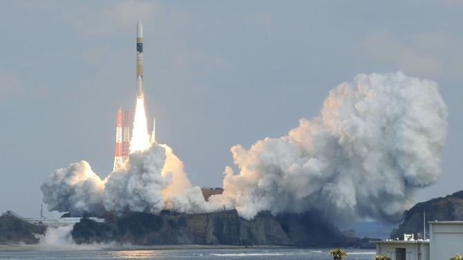 A H-IIA rocket carrying a backup radar satellite for intelligence gathering by the government off from the launching pad at Tanegashima Space Center