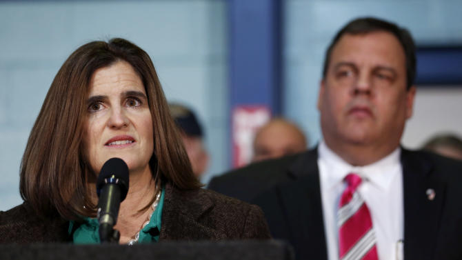"""New Jersey First Lady Mary Pat Christie, left, talks during a news conference while standing next to her husband, Gov. Chris Christie, Monday, Nov. 26, 2012, in Middletown, N.J. Gov. Christie announced he will seek re-election to a second term. Christie says he want New Jerseyans to know that he's """"in this for the long haul"""" as he leads the state's recovery from Superstorm Sandy.  (AP Photo/Julio Cortez)"""