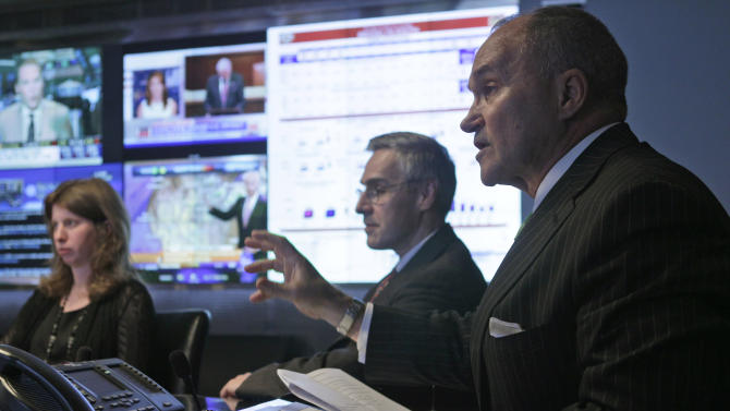 FILE - In this July 28, 2011 file photo, New York City Police Commissioner Raymond Kelly, right, speaks with members of the media prior to a tour of the Lower Manhattan Security Coordination Center, in New York. Kelly is credited with shaping the NYPDís counterterrorism effort, assigning 1,000 officers to counterterrorism duties daily and pioneering a program to send officers overseas to report on how other cities deal with terrorism. At center is NYPD Deputy Commissioner for Counterterrorism Richard Daddario, and NYPD Director of Counterterrorism policy and Planning Jessica Tisch is at left.  (AP Photo/Mary Altaffer, File)