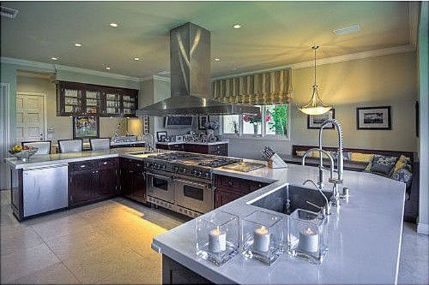 Nader Nazemi-The kitchen features a stainless steel commercial-grade Viking double oven. (Zillow.com)