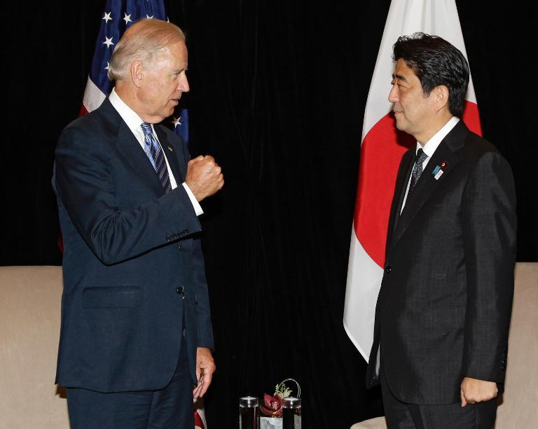 US Vice President Joe Biden (L) speaks with Japan's Prime Minister Shinzo Abe, in Singapore on July 26, 2013