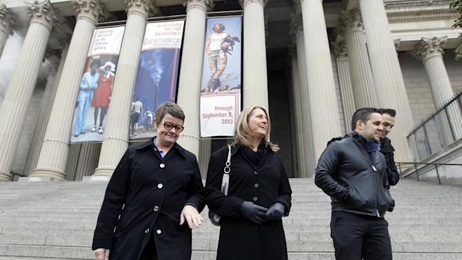 From left, Kris Perry, Sandy Stier of Berkeley, Calif., and Jeff Zarrillo and Paul Katami of Burbank, Calif., arrive to visit the National Archives in Washington, Monday, March 25, 2013, to view the U.S. Constitution, a day before their same-sex marriage case is heard before the Supreme Court.  (AP Photo/Jose Luis Magana)