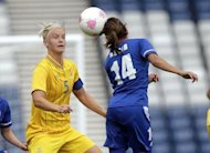 Sweden's Nilla Fischer (L) clashes with France's Louisa Necib (R) during a London 2012 Olympic Games women's football match at Hampden Park, Glasgow, Scotland. France won 2-1