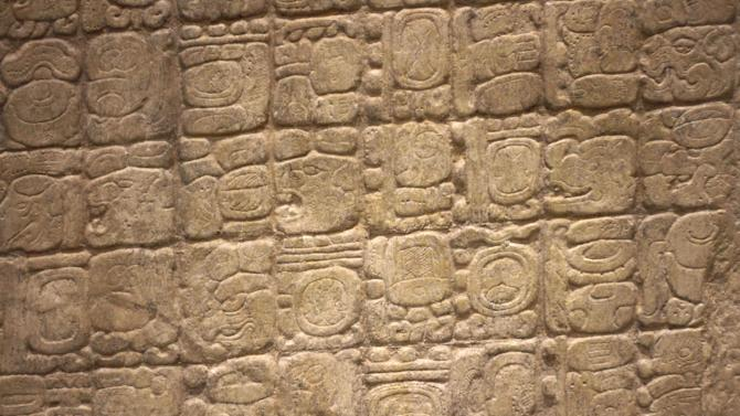 This Dec. 14, 2012 photo shows a detail of a replica of the Sixth Monument, which mentions the 13th Baktun, the end of a major 5,125-year cycle in the Mayan Long Count calendar, on display at the Mayan Museum in Cancun. Amid a worldwide frenzy of advertisers and new-agers preparing for a Maya apocalypse, one group is approaching Dec. 21 with calm and equanimity calm _ the people whose ancestors supposedly made the prediction in the first place. Mexico's 800,000 Mayas are not the sinister, secretive, apocalypse-obsessed race they've been made out to be. (AP Photo/Israel Leal)