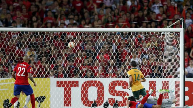 Australia's James Troisi scores a goal against South Korea during extra time of their Asian Cup final soccer match at the Stadium Australia in Sydney