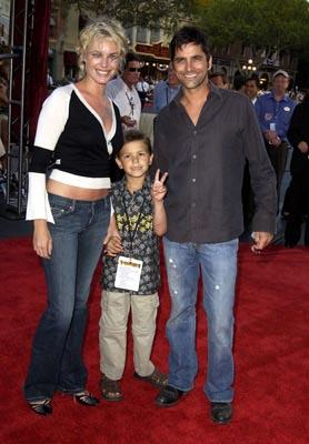 Premiere: Rebecca Romijn Stamos and John Stamos at the LA premiere of Walt Disney's Pirates Of The Caribbean: The Curse of the Black Pearl - 6/28/2003