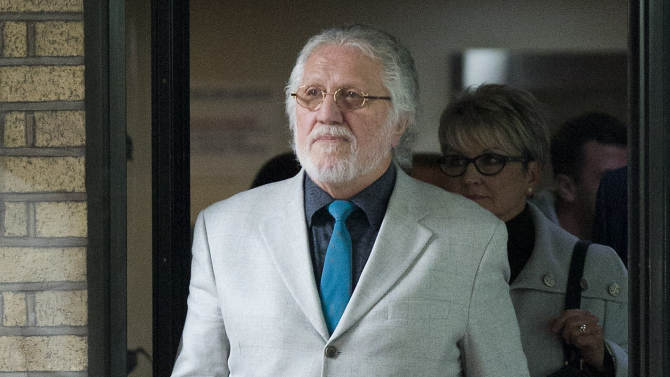Veteran Disc Jockey Dave Lee Travis leaves Southwark Crown Court in London Tuesday Sept. 23, 2014.  A jury has found veteran British radio DJ Dave Lee Travis guilty of indecent assault. The 69-year-old Travis, whose real name is David Griffin, was cleared on two other assault charges on Tuesday. (AP Photo/Justin Tallis/PA) UNITED KINGDOM OUT