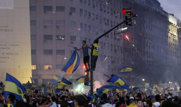 Fans of Argentine soccer team Boca Juniors take part in celebrations of Boca Juniors Fan Day in Buenos Aires