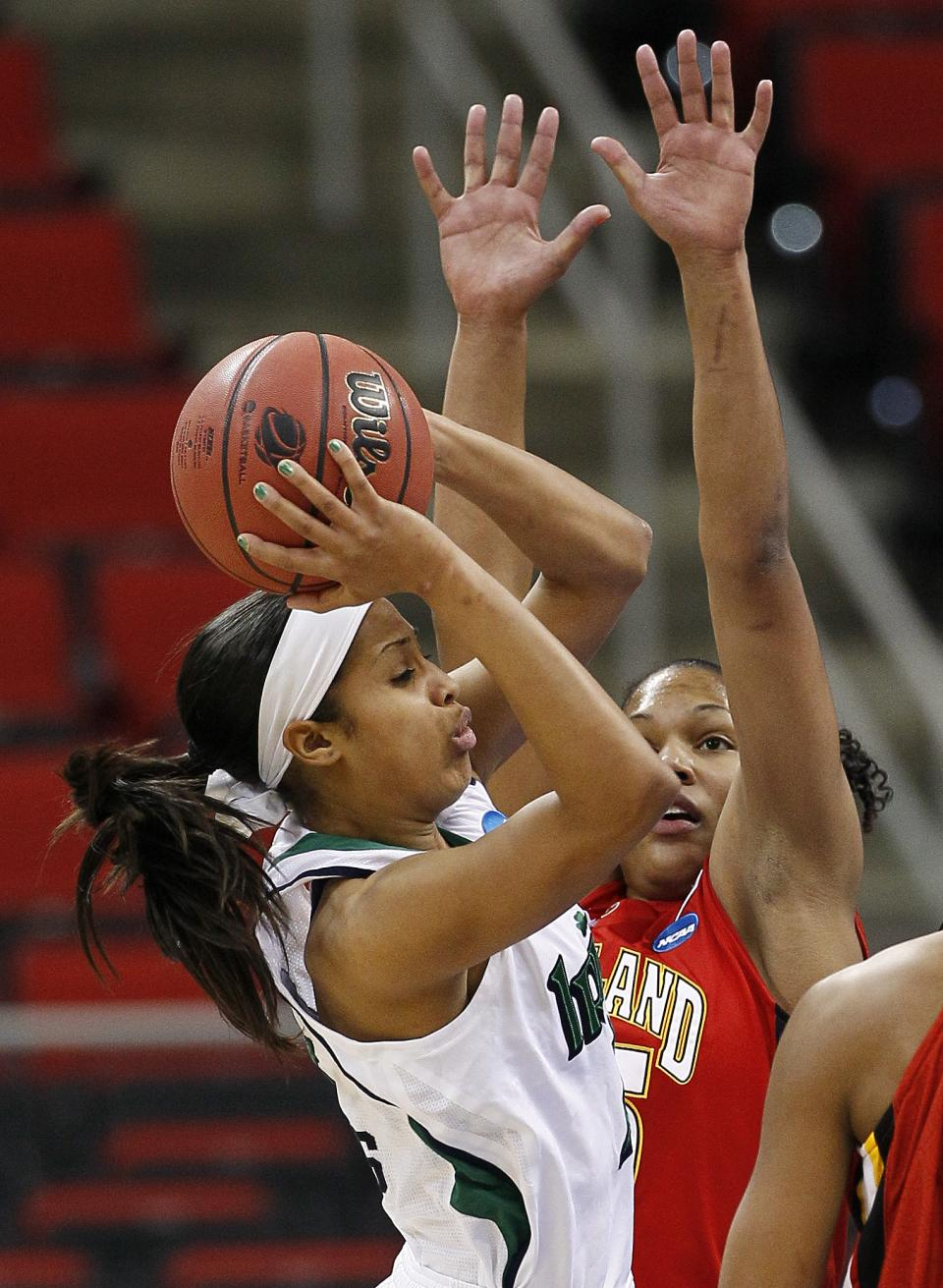 Notre Dame's Skylar Diggins, left, shoots while Maryland's Alyssa Thomas defends during the first half of an NCAA women's college basketball tournament regional final in Raleigh, N.C., Tuesday, March 27, 2012. (AP Photo/Gerry Broome)