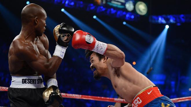 (R-L) Manny Pacquiao Throws Getty Images
