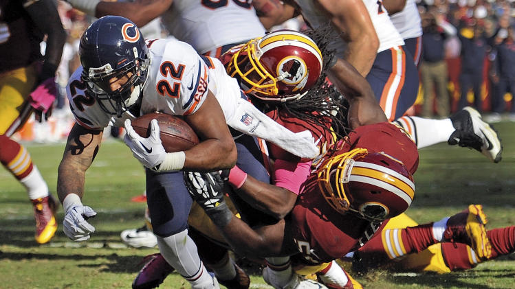 Chicago Bears running back Matt Forte (22) drags Washington Redskins strong safety Brandon Meriweather, center, and inside linebacker London Fletcher, right, into the end zone for a touchdown during the second half of a NFL football game in Landover, Md., Sunday, Oct. 20, 2013. (AP Photo/Nick Wass)