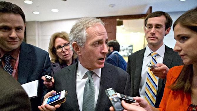FILE - This Nov. 13, 2012 file photo shows Senate Banking Committee member Sen. Bob Corker, R-Tenn. pursued by reporters on Capitol Hill in Washington, Corker is spending a lot of time lately talking to Democrats. The freshman lawmaker from Tennessee spoke briefly last week with Treasury Secretary Timothy Geithner after he unveiled his 10-year, $4.5 trillion solution to averting the end-of-year, double economic hit of tax hikes and automatic spending cuts. Deficit-cutting maven Erskine Bowles had forwarded Corker's proposal to White House Chief of Staff Jack Lew.  (AP Photo/J. Scott Applewhite, File)